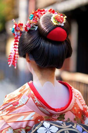 geisha kimono: Momoware - traditional hairstyle of a young Maiko