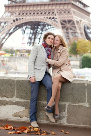 Beautiful romantic couple in Paris near the Eiffel Tower photo