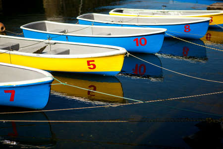 yellow boats: Row of colorful blue and yellow boats Stock Photo