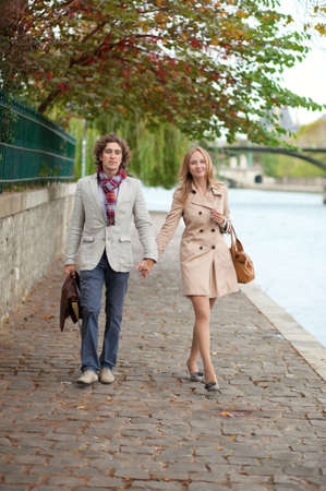 Romantic couple in Paris, walking by the embankment photo