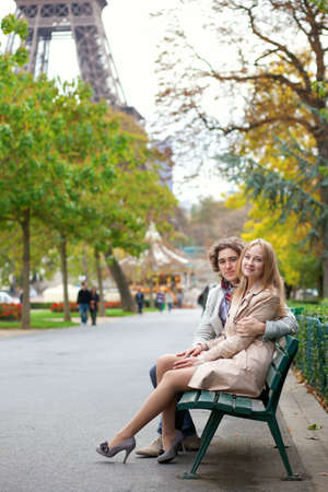 Romantic couple in Paris by the Eiffel Tower photo