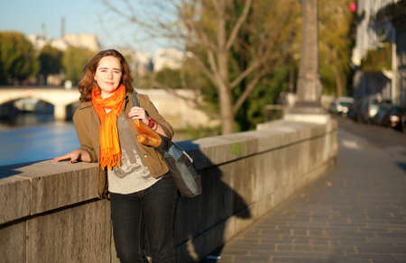 Beautiful young woman enjoying early sunny morning in Paris photo