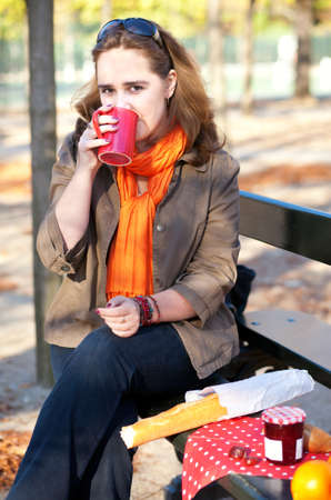 jardin de luxembourg: Beautiful young girl having picnic in a park Stock Photo