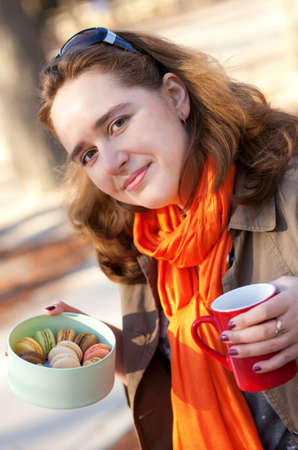 Beautiful young girl with macaroons and tea Stock Photo - 11977955