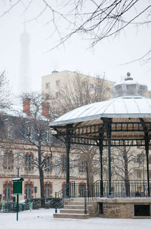 Winter in Paris. Small Parisian park with snow photo
