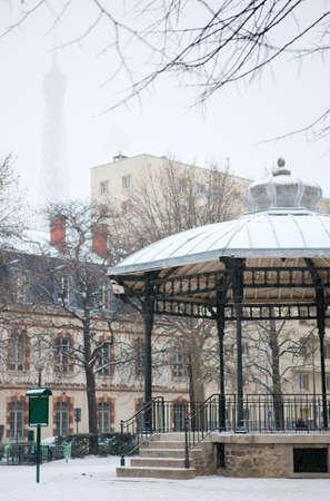 Winter in Paris. Small Parisian park with snow photo
