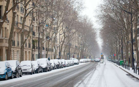 Winter in Paris. Parisian street covered with snow photo