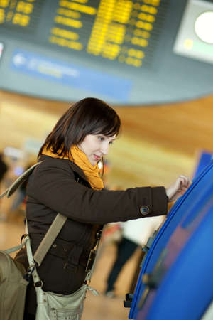 brune: Girl doing self-checkin in the airport