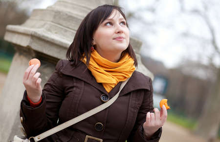 brune: Beautiful young girl eating macaroons in Paris Stock Photo