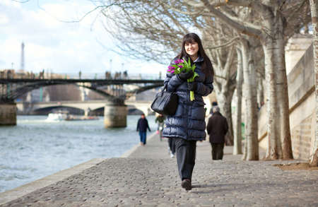 Happy beautiful girl with tulips enjoying spring day in Paris Stock Photo - 12426014