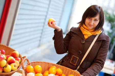 brune: Beautiful young customer selecting apples at market