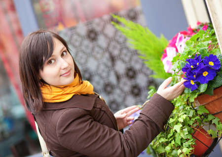 brune: Beautiful young woman with flowers outdoors Stock Photo