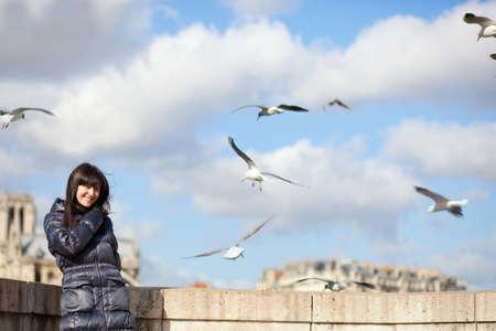 Happy brunette girl in Paris enjoying windy spring day photo