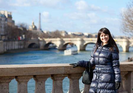 brune: Pretty brunette female tourist in Paris Stock Photo