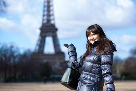 Smiling tourist near the Eiffel tower photo