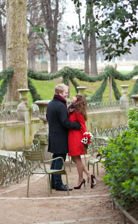 Romantic couple in love having a date in the Luxembourg garden photo