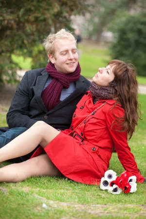 Happy couple in love having a date and sitting on the grass Stock Photo - 12660230