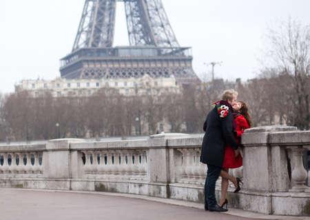 Romantic couple in love in Paris, near the Eiffel tower photo