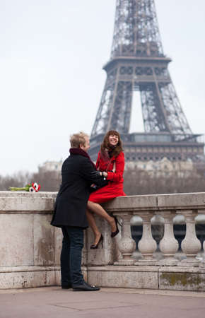 Romantic couple in love in Paris, near the Eiffel tower Stock Photo - 12660228