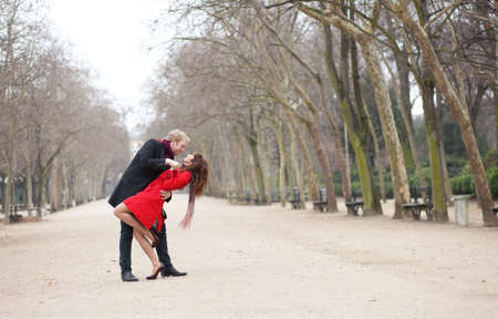 Dating couple dancing in a park Stock Photo