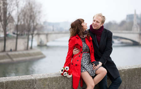 Dating couple at the Parisian embankment photo