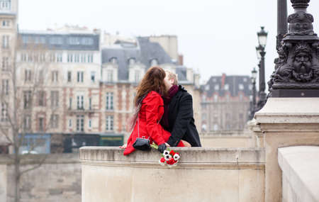 Beautiful romantic couple having a date and kissing photo