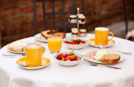 Delicious breakfast with fruit salad, fresh juice and coffee served for two