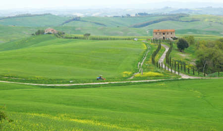 Typical Tuscany landscape with farmhouse, fields and roads photo
