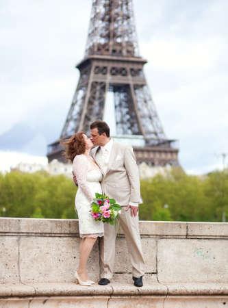 Wedding in Paris. Happy married couple near the Eiffel Tower