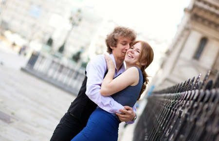 Young romantic couple outdoors, laughing photo