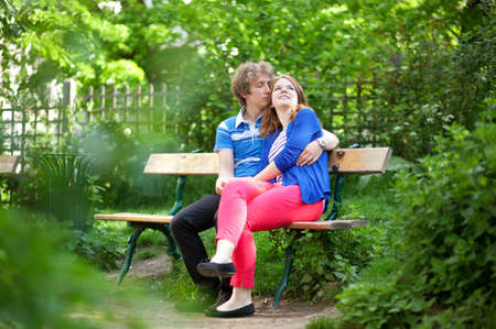 Young loving couple having a date in a garden photo