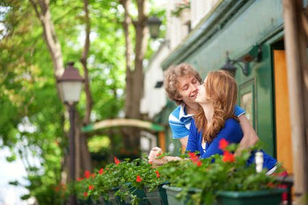 Romantic couple on the balcony of their house or hotel photo
