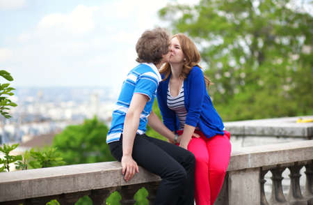 Happy young couple kissing on Montmartre Stock Photo - 13703459