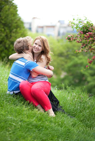 Young happy couple having fun together in park Stock Photo - 13703470