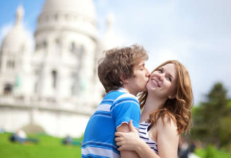 Couple of tourists kissing by the Sacre-Coeur in Paris Stock Photo - 13792149