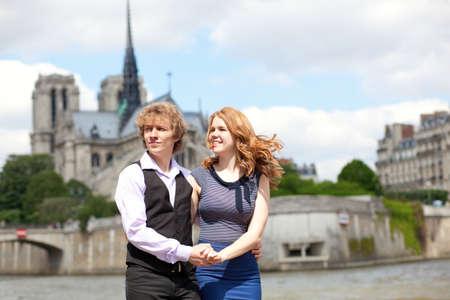 Young beautiful couple in Paris, enjoying their walk photo