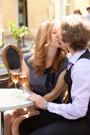 Romantic date in a cafe with rose wine photo