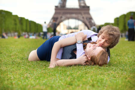 Laughing couple lying on the grass near the Eiffel Tower Stock Photo - 13792208