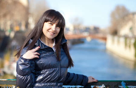 Portrait of beautiful brunette tourist in Paris at spring photo