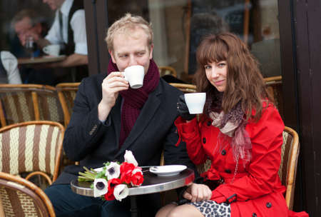Happy couple having a date in Parisian cafe photo