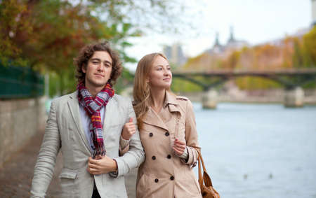 Romantic couple in Paris at fall, having a date Stock Photo - 13998107
