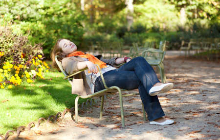 Beautiful young woman enjoying warm autumn or spring day photo