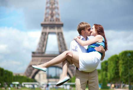 honeymoon couple: Man carrying his girlfriend in his arms in Paris