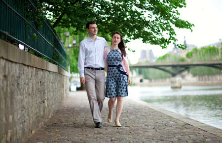 Romantic couple is having a stroll by the Seine in Paris photo