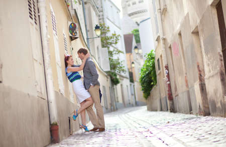 Sensual couple on a street of Montmartre in Paris photo
