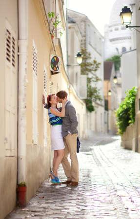 montmartre: Romantic couple kissing on a street of Montmartre in Paris