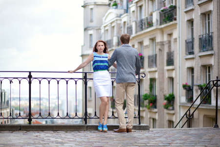 Beautiful couple at viewpoint on Montmartre in Paris photo