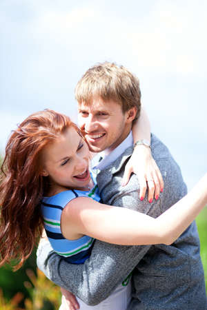 Happy positive romantic loving couple is hugging and laughing Stock Photo - 14422546