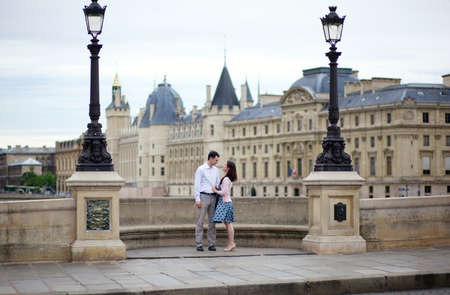 Dating couple in Paris on a bridge Stock Photo