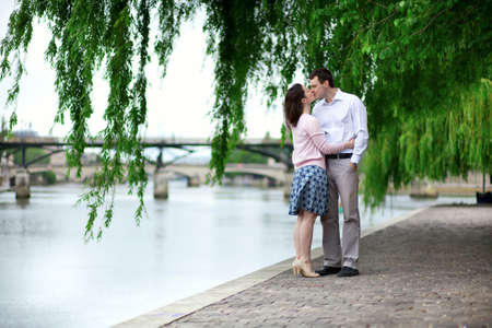 Romantic dating couple is kissing under the willow photo